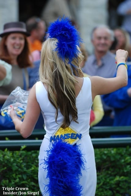 Girl wearing blue tail and hansen sign credited