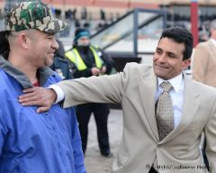 Trainer Rudy Rodriguez celebrates after Vyjack wins the Gotham S.
