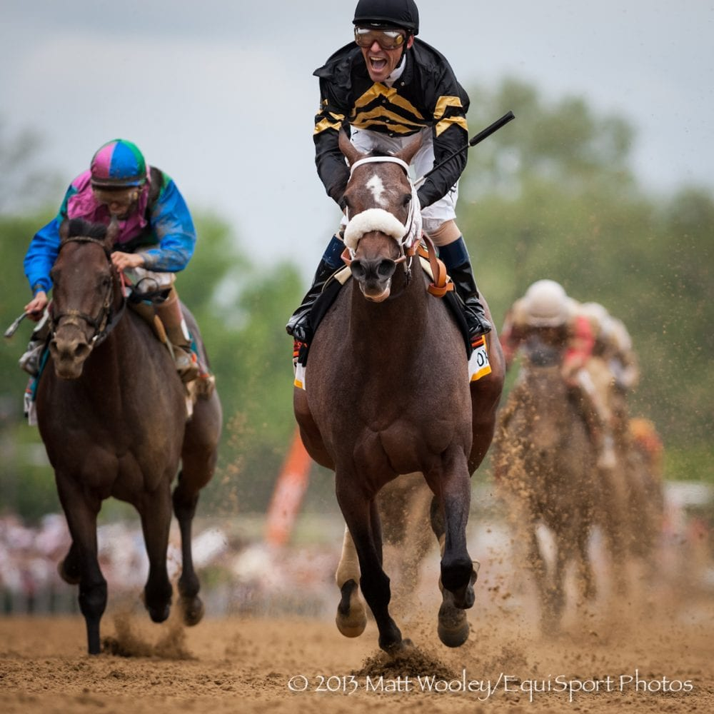 Gary Stevens celebrates after winning Preakness with Oxbow
