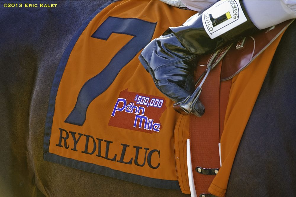 Rydilluc, Edgar Prado up, wins the inaugural Penn Mile at Penn National Race Course in Grantville, PA.
