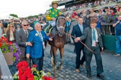 Cot Campbell (right) and friend Paul Oreffice  (left) lead Palace Malice through victory lane after Belmont Stakes
