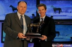 Rick Balaz, president and general manager (left), receiving Sovereign Award from Woodbine CEO Nick Eaves.