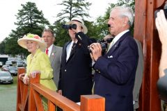 Saratoga 150 Honorary Chairs Marylou Whitney (front left) and John Hendrickson (center with binoculars) are joined by W.C. Whitney's great grandson Lev Miller (right) and The New York Racing Association, Inc. CEO and President Chris Kay (back left) for the official first viewing from the Whitney Viewing Stand overlooking the Oklahoma Training Track at Saratoga Race Course on Thursday, August 1