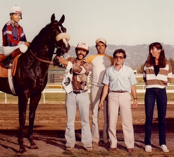 Old friends Mark Couto (second from right) and Carla Gaines, at Golden Gate Fields after a 1984 victory by Big Eric
