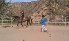 Bonnie & Maxwell during a riding lesson