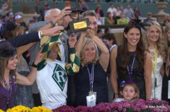 Kathy Ritvo, Gary Stevens, and the rest of Mucho Macho Man's connections celebrate the Breeders' Cup win