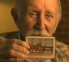 Broun holding a photo of Secretariat