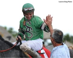 Castellano celebrates aboard I Ain't Gonna Lie after breaking the single-season earnings mark