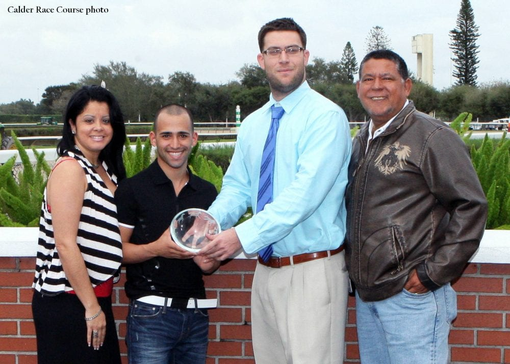 John Delgado (2nd left) accepts award for being the leading jockey at the 2013 Tropical at Calder meet