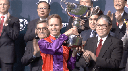Kerrin McEvoy raises the trophy after winning the 2013 Longines International Jockeys' Championship