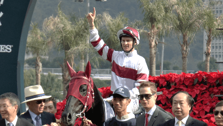 Jockey Zac Purton celebrates victory aboard Dominant in the Longines Hong Kong Vase