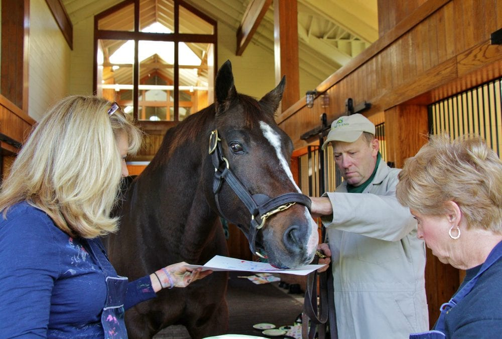 "A.P. Indy, seen here painting a ""Moneigh,"" has also proven an artist when it comes to producing winners and sires of winners"
