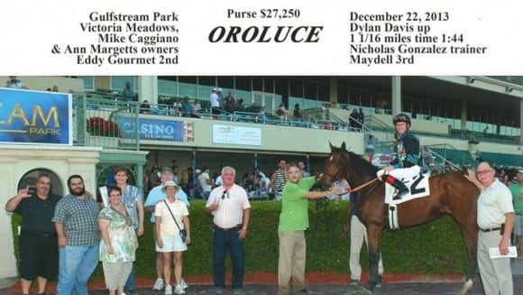 Mike Caggiano and fellow owners celebrate Oroluce's victory at Gulfstream Park