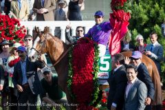 Victor Espinoza celebrates California Chrome's win in the 2014 KY Derby