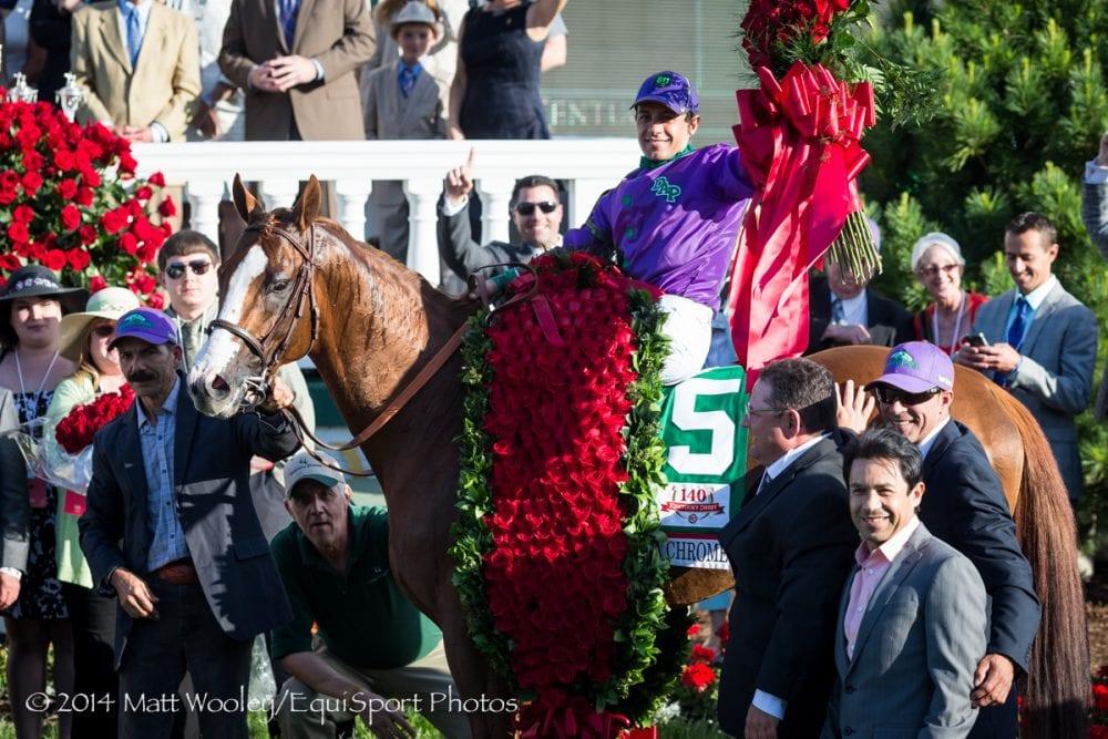 Victor Espinoza celebrates California Chrome's win in the 2014 KY Derby