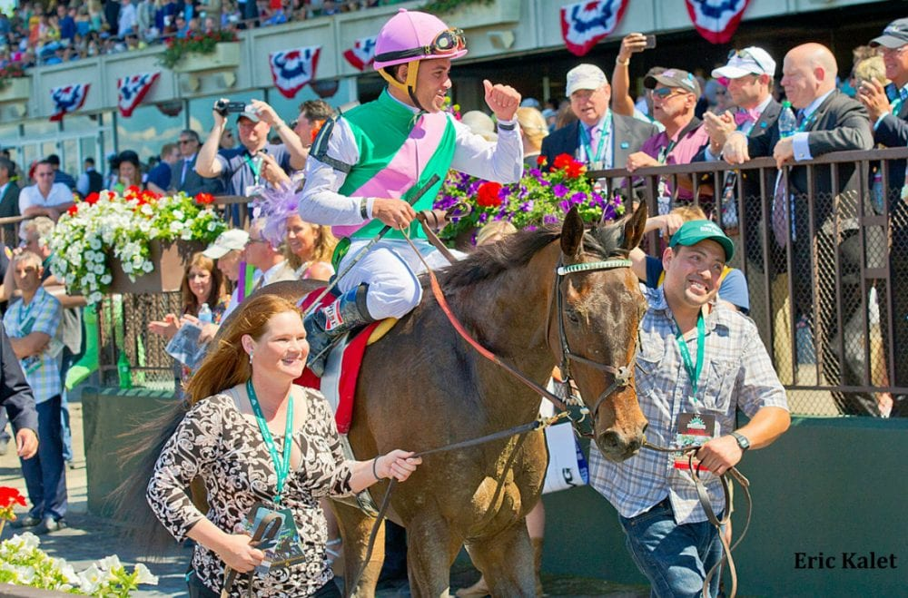 Owners and fans cheer Close Hatches following her win in the Ogden Phipps