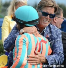Ernie Semersky of Conquest Stables, embracing jockey Patrick Husbands