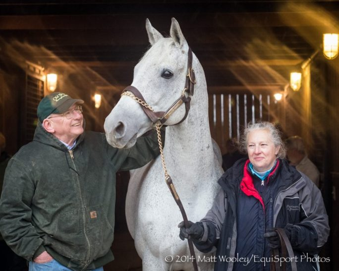 Michael Blowen and Sandy Hatfield pose with champion Silver Charm at Old Friends in Georgetown. Silver Charm arrived back in the US Dec. 1