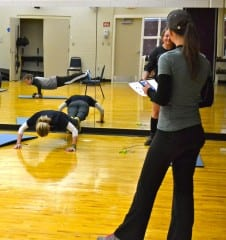 McManigell, a NARA graduate herself, times a group of students during a physical fitness assessment.