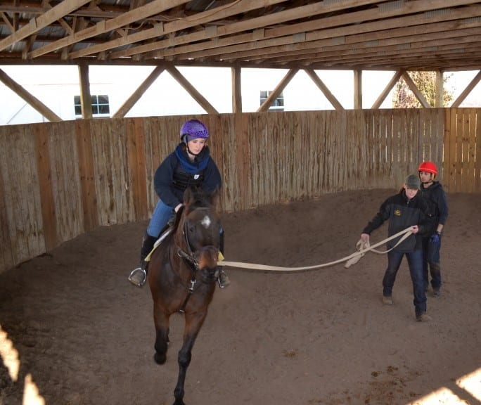 McManigell works with North American Racing Academy student Kristina Renn on her posting trot