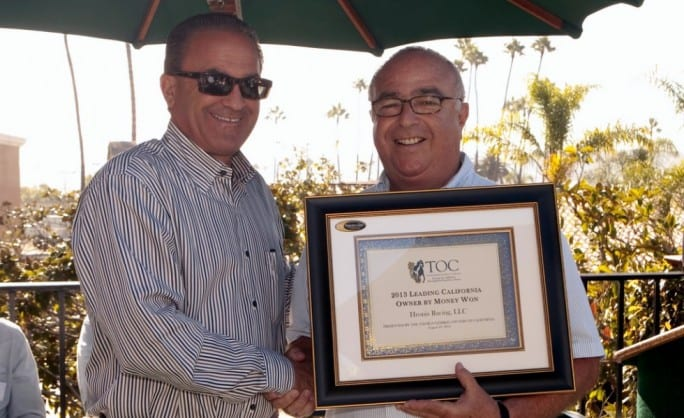 Kosta Hronis (left) accepts the award from TOC director Mike Wellman for California's top owner by money won in 2013
