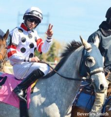 Tyler Pizarro salutes Loiselle during the post parade