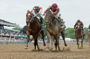March (inside) and Cinco Charlie battle to the wire in the G2 Woody Stephens