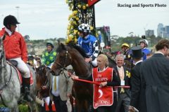 Protectionist and jockey Ryan Moore after winning last year's Melbourne Cup.