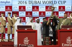Frank Taylor hoists the Dubai World Cup trophy with co-owner Perry Martin