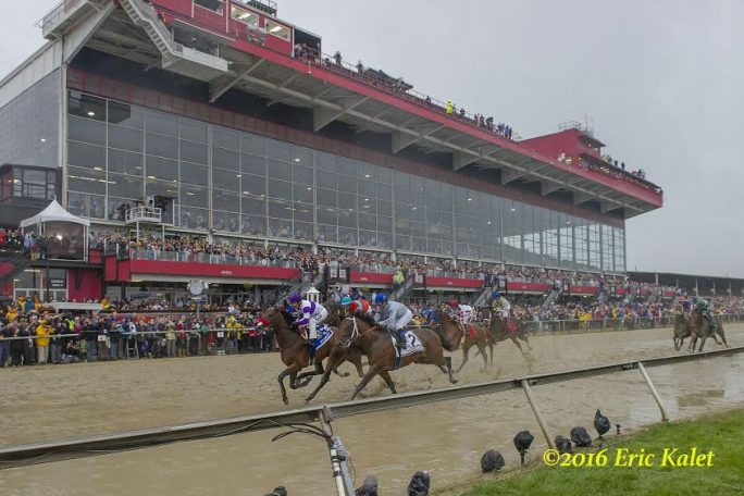 Nyquist takes the lead the first time past the stands in the 2016 Preakness at Pimlico.