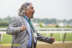 A joyous Asmussen celebrates as Creator is declared the winner.