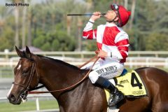 Mike Smith celebrates after Songbird wins the Summertime Oaks