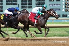 Churchill Downs Racing Club's Dial Me breaks her maiden at Ellis Park