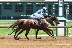 Arturo Aparicio wins his first US race at Ellis Park aboard National Girl