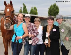 Monique Snowden (far left) with best friend Shauna Morrissey (closest to Snowden in plaid shirt) and other friends at Emerald Downs