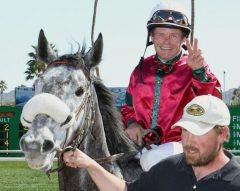 Dennis Collins aboard his 2,000th career winner, Justcallheraggie, at Turf Paradise