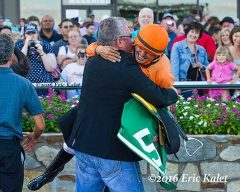 Dion celebrates with jockey Eurico Rosa da Silva after Noholdingback Bear's victory at Parx