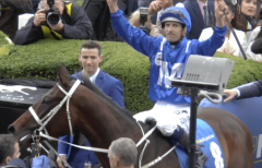 Hugh Bowman celebrates aboard Winx after her 2nd consecutive Cox Plate victory
