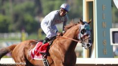 Victor Espinoza smiles as California Chrome wins the Awesome Again