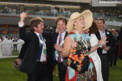 Trainer Jamie Osborne (center) celebrates Toast of New York's win in the 2014 UAE Derby