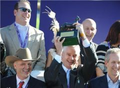 Dobson hoists the Breeders' Cup trophy following Caleb's Posse's victory in 2011