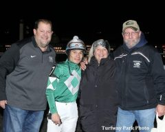 Trainer Jeff Greenhill, right, celebrates his 500th career victory