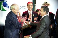 Officials with Maroñas racetrack owner Codere present the trophy following the 119th running of the Clásico Gran Premio José Pedro Ramírez