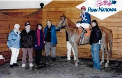 Arthur Kelley (second from left) in the winner's circle with Mi Mister D