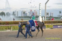Jockey Mike Smith and  Arrogate celebrate after winning the 2017 Pegasus World Cup Invitational at Gulfstream Park.
