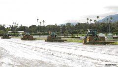 Crews work on Santa Anita's main track Thursday