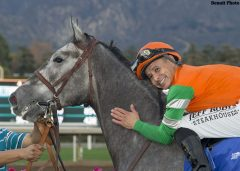 Jockey Mike Smith has a moment with Unique Bella after their victory in the Grade II, $200,000 Santa Ynez Stakes