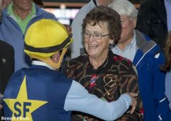 Cathy Schroeder celebrates with jockey Kent Desormeaux in the winner's circle after Blue Tone's victory in the San Gabriel Stakes