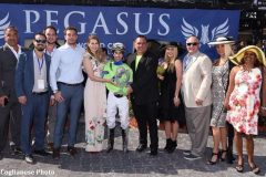 Paolucci (right of jockey Antonio Gallardo) enjoys the winner's circle after Imperative's Poseidon victory