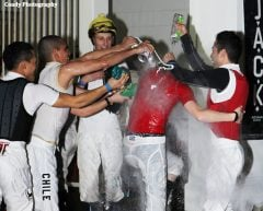 Shelbi Kurtz undergoes traditional initiation from the Turfway Park jockey colony after riding her first winner Feb. 22